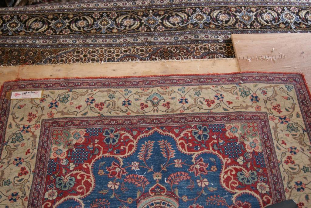 This Antique piece has been very finely woven and had previously had its fringes damaged. The previous weaver had decided to secure the edges without the use of fringes thereby creating a frame around the rug that did not look suitable for this rugs design. Therefore our customer had decided to add the fringes to both sides of this rug which you can see in the next images.